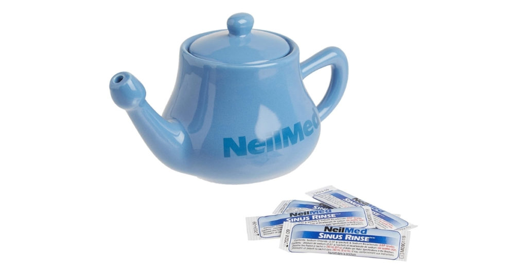 A package of sinus rinse is mixed in with warm distilled water inside the pot and the end is placed inside on the nostril. While your mouth remains open, you pour the liquid into your nostril and it comes out the other one.